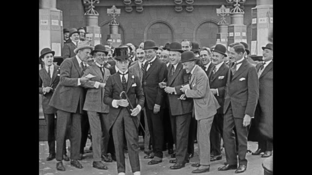1920 new trader is bullied on trading floor of stock exchange (buster keaton) - harassment stock videos & royalty-free footage