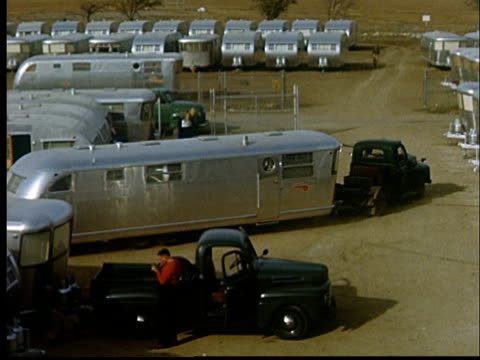 ws, ha, new trailer pulling out of factory lot, 1950's, oklahoma, usa - camper trailer stock videos and b-roll footage