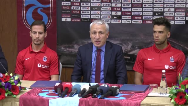 New transfers Argentinian Emmanuel Mas and Portugese Joao Pereira of Trabzonspor attend a contract signing ceremony alongside vice president of...