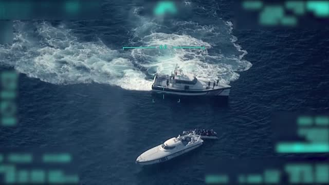 new turkish unmanned aerial vehicle footage shows a greek coast guard ship in the aegean sea illegally pushing back a boat of asylum seekers,... - greece stock videos & royalty-free footage