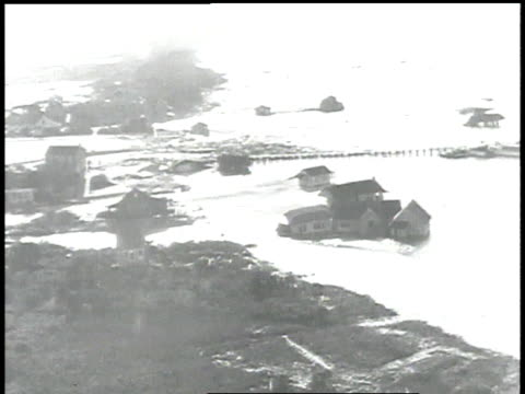 stockvideo's en b-roll-footage met new united kingdom hurricane washes away beaches and damages bridges / united states - 1938