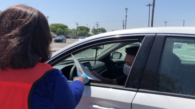 CA: Drive-In Naturalization Ceremony Held In Southern California
