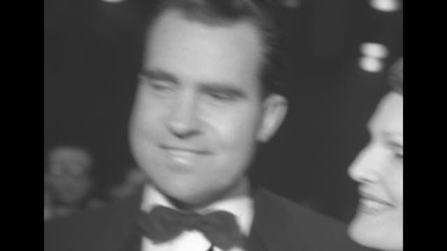 VS new Vice President Richard Nixon wife Patricia / John Wayne comes to stage with Irene Dunne