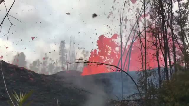 stockvideo's en b-roll-footage met new video has captured lava bursting from volcanic fissures in the ground in the leilani estates neighborhood of hawaii on may 5. the big island's... - https