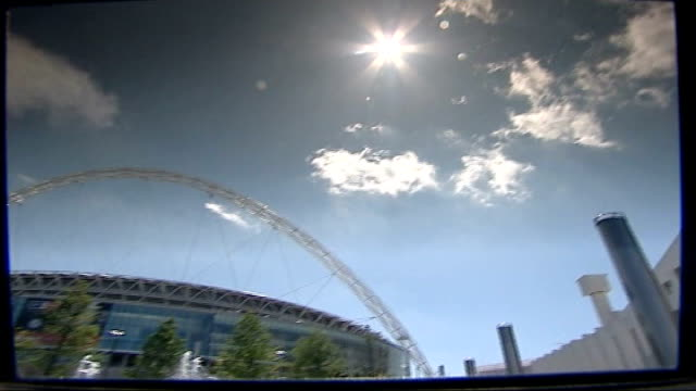 new wembley stadium prepares to host fa cup; england: london: wembley: ext ornamental fountain outside new wembley stadium - wembley stadium stock videos & royalty-free footage