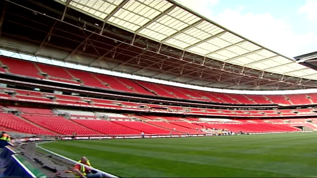 stockvideo's en b-roll-footage met new wembley stadium prepares to host fa cup general view of interior of wembley stadium pan around - fa cup
