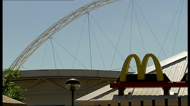 new wembley stadium prepares to host fa cup; maintenance workers pushing lawn-rollers along wembley stadium turf wembley stadium arch with mcdonald's... - turf stock videos & royalty-free footage