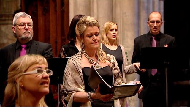 new work by sir john taverner performed in the week of his death; cutaway south iceland chamber choir rehearsing thorhallsdottir singing with the... - choir stock videos & royalty-free footage