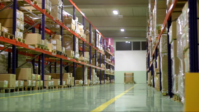 stockvideo's en b-roll-footage met new working day in the warehouse - turning on or off