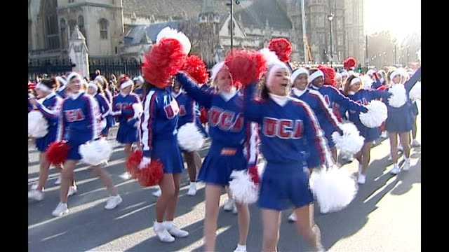 preparations for london celebrations date various of marching bands and cheerleaders taking part in new year's parade - チアリーダー点の映像素材/bロール