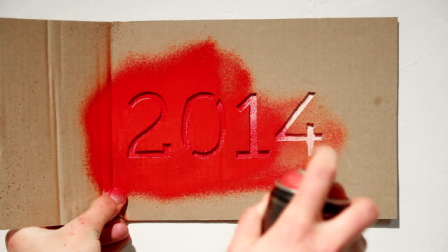 new year 2014 graffiti stencil painting - spray painting stock videos & royalty-free footage