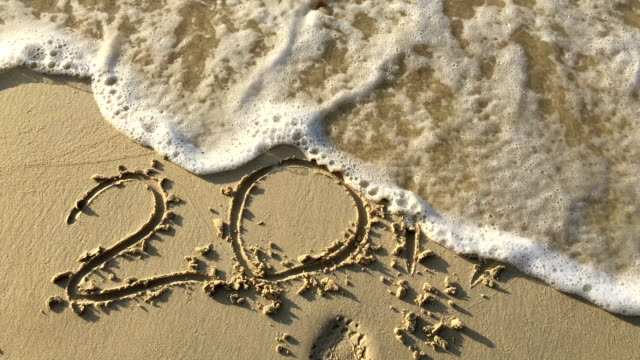 ์New year 2017  of an inscription on sand the beach.