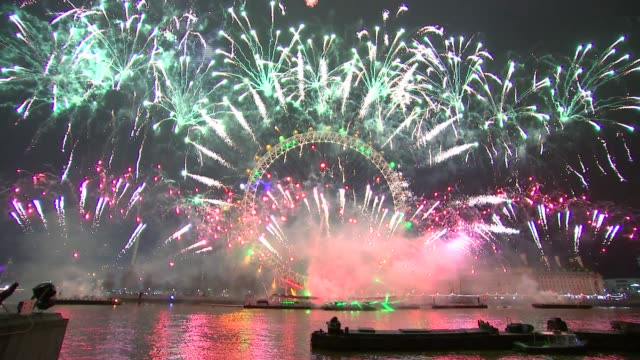 central london fireworks; ** pop music audible at some points ** location: england: london: victoria embankment: ext / night gvs new year fireworks... - firework display stock videos & royalty-free footage