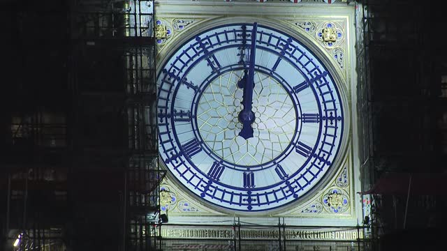 new year 2021 celebrations: big ben strikes midnight; england: london: westminster: ext at night hands of big ben advancing towards midnight and big... - clock tower stock videos & royalty-free footage