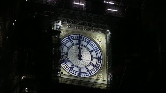 arrival of 2021 marked with muted celebrations around the world; england: london: ext at night big ben striking midnight sot. - clock tower stock videos & royalty-free footage