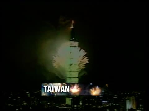 new year celebrations around the world via taipei various shots of firework display on 'tapei 101' the world's tallest building - taipei 101 stock-videos und b-roll-filmmaterial