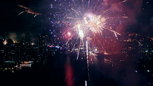 new year celebrations firework aerial view - firework display stock videos & royalty-free footage