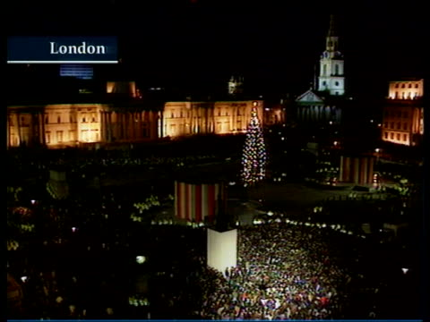 New Year Celebrations RUSSIA/SOUTH AFRICA/ENGLAND New Year Celebrations NIGHT ENGLAND London LTGV Trafalgar Square with mass of people and lighted...