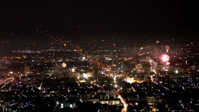 new year fireworks and flying lanterns over chiang mai city, thailand. - chiang mai city stock videos and b-roll footage