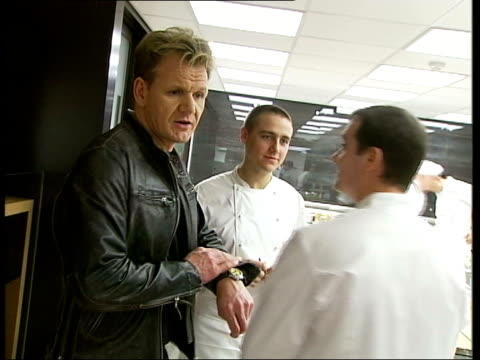 new year honours list file / r25050514 london maze int chef restaurant owner gordon ramsey talking to chefs in kitchen - gordon ramsay stock videos and b-roll footage