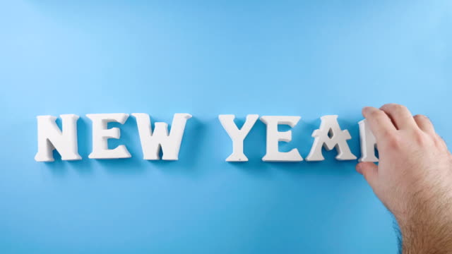 new year letter on blue background - newsprint stock videos and b-roll footage