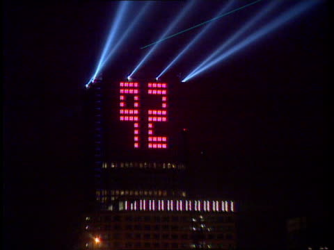 London Docklands Canary Wharf GV Canary Wharf building MS '92' displayed on building in lights with lasers next PULL CMS Helen Marriage intvwd SOF...