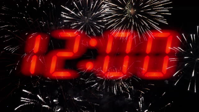 new year midnight countdown fireworks celebration. pulsating 12.00. - midnight stock videos & royalty-free footage