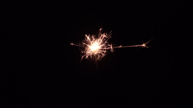 new year party sparkler on black background - sparkler stock videos & royalty-free footage