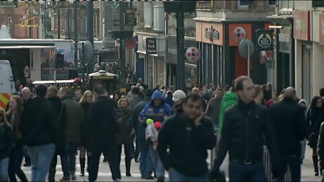 new year rises in vat stamp duty threshold and rail prices england leeds ext shoppers along busy high street past shops displaying 'sale' signs - vat stock videos & royalty-free footage