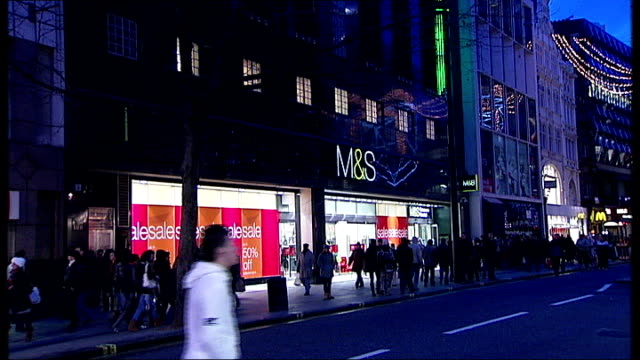 new year rises in vat stamp duty threshold and rail prices london oxford street exterior of marks spencer store with shoppers walking past neon... - vat stock videos & royalty-free footage