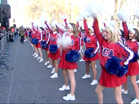 new year's day parade in london more of cheerleaders past and performing / audience cheering - チアリーダー点の映像素材/bロール