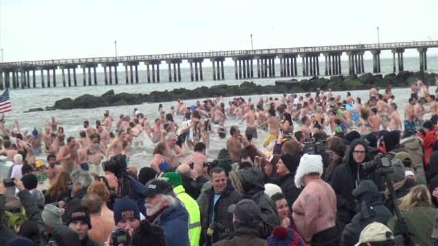 new year's day polar bear swimmers plunge into atlantic ocean in coney island, nyc - salmini stock videos & royalty-free footage