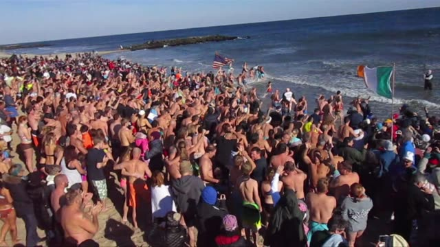 new year's day polar bear swimmers plunge into atlantic ocean - salmini stock videos & royalty-free footage