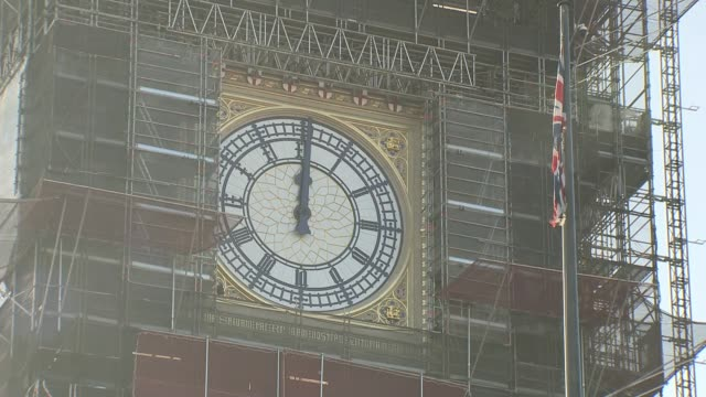preparations for celebrations underway; england: london: westminster: ext various of big ben, shrouded in scaffolding with clock face visible, as... - big ben stock videos & royalty-free footage