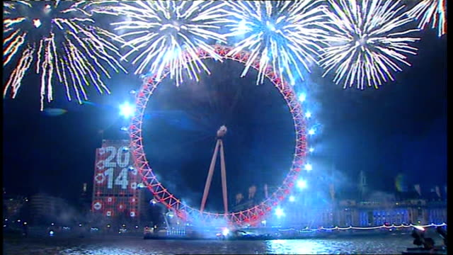 New Year's Eve Celebrations Clean up operation ENGLAND London New Year's Eve fireworks display around London Eye with '2014' backdrop as Big Ben...