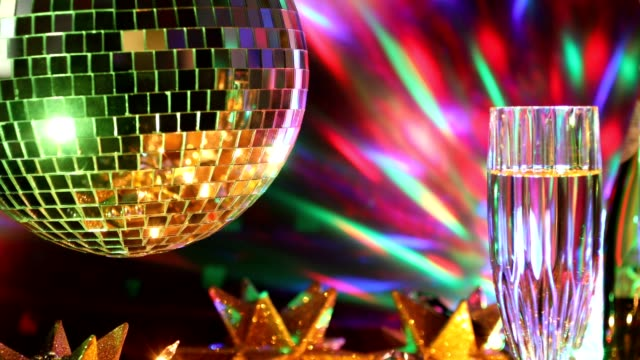 New Year's Eve holiday party with champagne, disco ball, decorations.