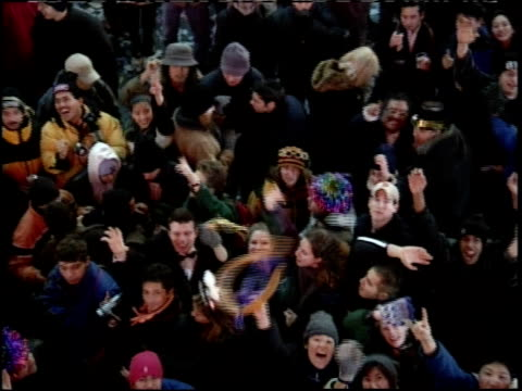 new year's eve in times square; crowd cheering and waving - 1999 stock-videos und b-roll-filmmaterial