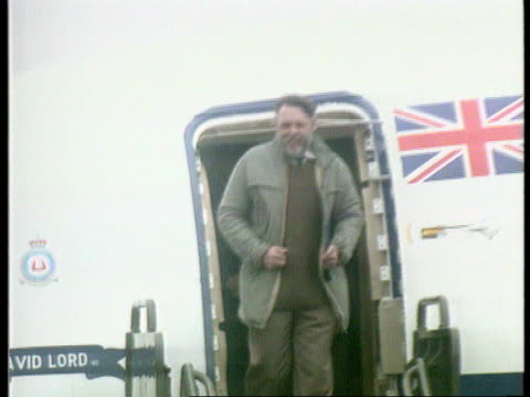 new years honours; england: wiltshire: raf lyneham terry waite out plane & waves cms waving terry tilt down down steps tx 19.11.91 - wiltshire stock videos & royalty-free footage