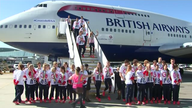 new year's honours list 2017; lib / t23081604 team gb waving from steps and on ground beneath plane for group photo - team photo stock videos & royalty-free footage
