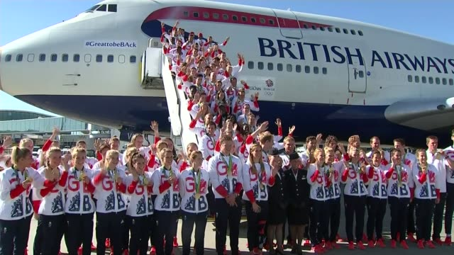 new year's honours list 2017: recipients announced; lib / tx 23.8.2016 team gb waving from steps and on ground beneath plane for group photo end lib - team photo stock videos & royalty-free footage