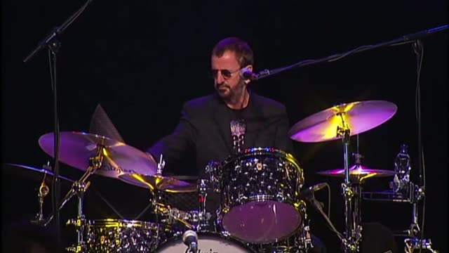 new year's honours list 2018; 1.6.2011 / r01061106 surrey: dunsfold park: int ringo starr playing drums with his band - ringo starr stock videos & royalty-free footage