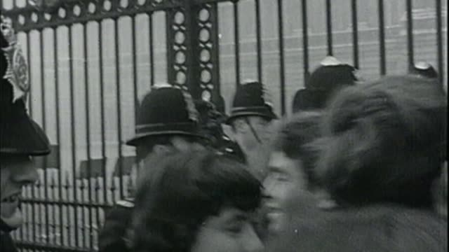 new year's honours list 2018 fs261065002 / tx london buckingham palace beatles fans screaming outside gates to buckingham palace sot b/w beatles fans... - jason george stock videos and b-roll footage