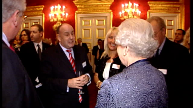 New Year's Honours List Chris Preddie awarded OBE R20020704 St James Palace EXT Queen Elizabeth II chatting to Charles Allen at NSPCC reception