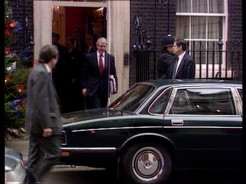 New Year's Honours List ENGLAND London Downing St No 10 John Major out No 10 to car CS Hands hold document headed 'Honours' ZOOM IN page turned