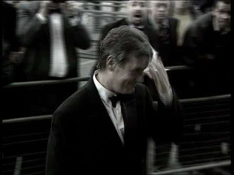 new year's honours list england london michael palin who receives the cbe along wearing evening dress pan int michael palin cbe interview sot reacts... - 光栄点の映像素材/bロール