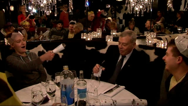 new year's honours list recipients announced location unknown int dickie bird pulling christmas cracker at dinner table dickie bird obe interview sot... - christmas cracker stock videos and b-roll footage