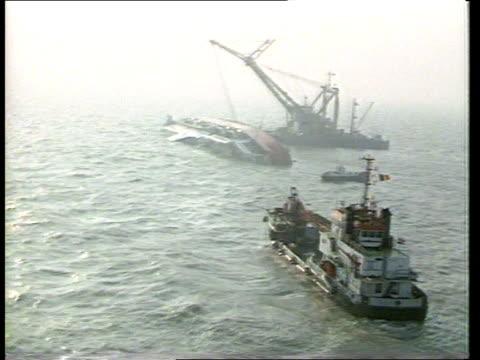 stockvideo's en b-roll-footage met zeebrugge ferry disaster heroes honoured transport / new years honours list zeebrugge ferry disaster heroes honoured tx 9387 a/v capsized ferry as... - zeebrugge