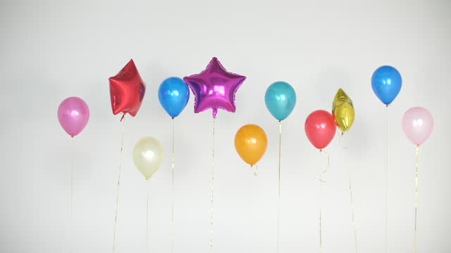 new year's party with balloons on white background - number stock videos & royalty-free footage