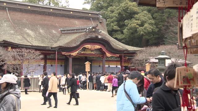 "New Years' prayer at ""Dazaifu Tenmangu Shrine"" The shrine is dedicated to Sugawara Michizane who is known as the god of learning All through the year..."