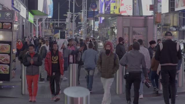 new york 2021 times square masked shoppers high angle billboards and screens busy crowd - new york city stock videos & royalty-free footage